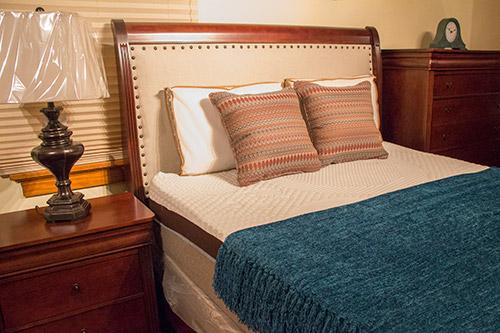 Cherry bedroom set with upholstered headboard from Wilk Furniture & Design in Random Lake
