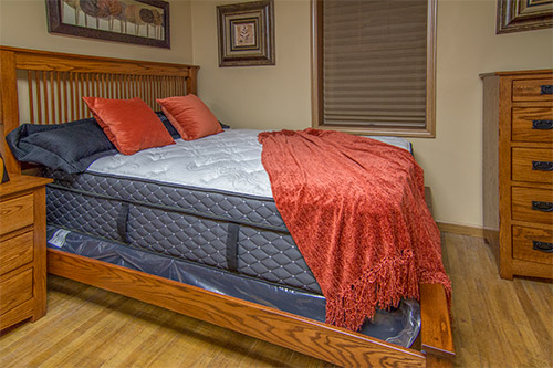 Mission style oak bedroom set with Restonic mattress from Wilk Furniture & Design in Random Lake