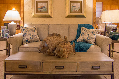 Transitional sofa with teal accessories by Wilk Furniture & Design in Random Lake