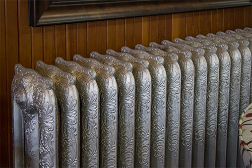 Historic decorative cast iron radiators at Wilk Furniture & Design in Random Lake
