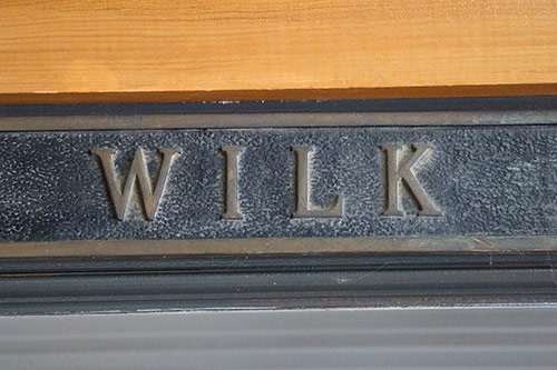 Historic lettering above the office at Wilk Furniture & Design in Random Lake